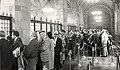 Before the electronic transfer of information, a Treasury auction at the Bank involved individuals waiting in line at the first floor cages of the Bank to purchase U.S. securities.   Today, this space is used for an array of public gatherings.  (c. 1970)